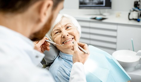 Older woman receiving dental treatment