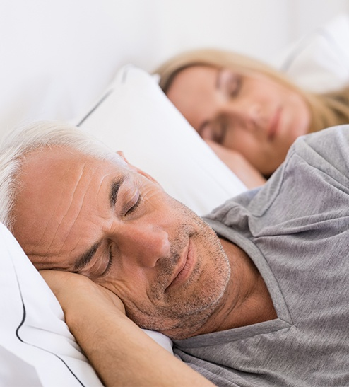 Man and woman sleeping soundly together