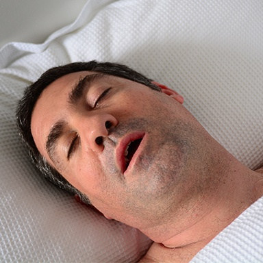 Sleeping man with mouth open