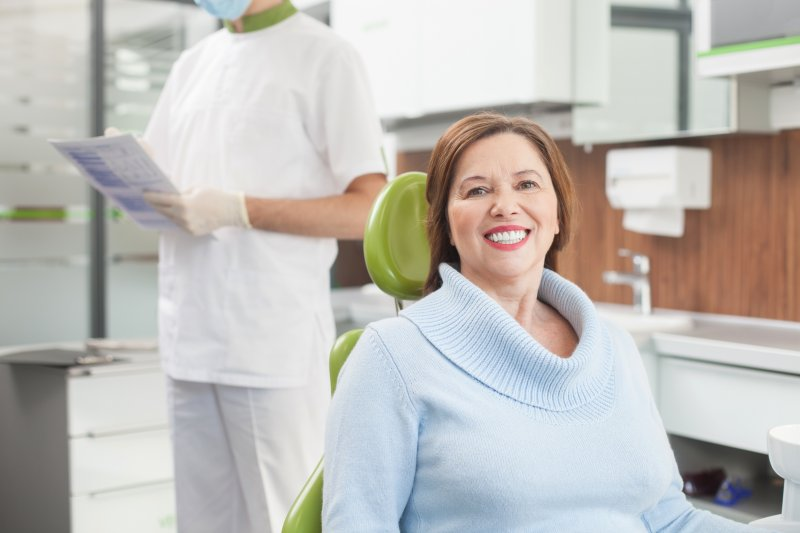 a woman in a dentist chair