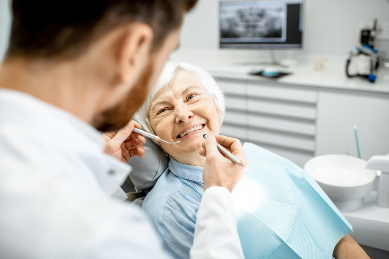 Woman smiling during dentist appointment
